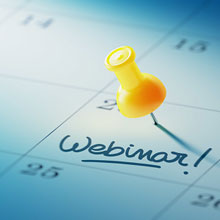 push pin marking webinar date on calendar